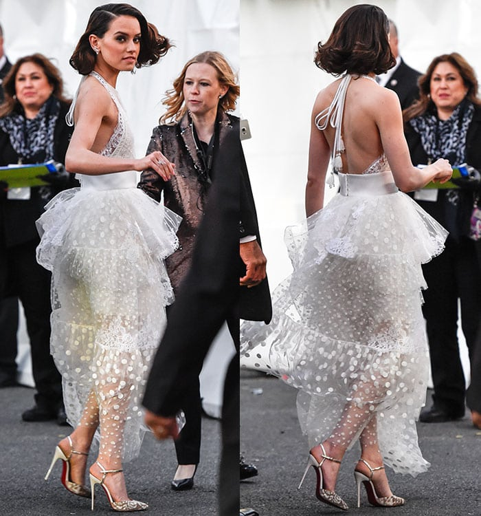 Daisy Ridley flaunts hersexy back and toned armsin a flattering white lace dress by Chloe