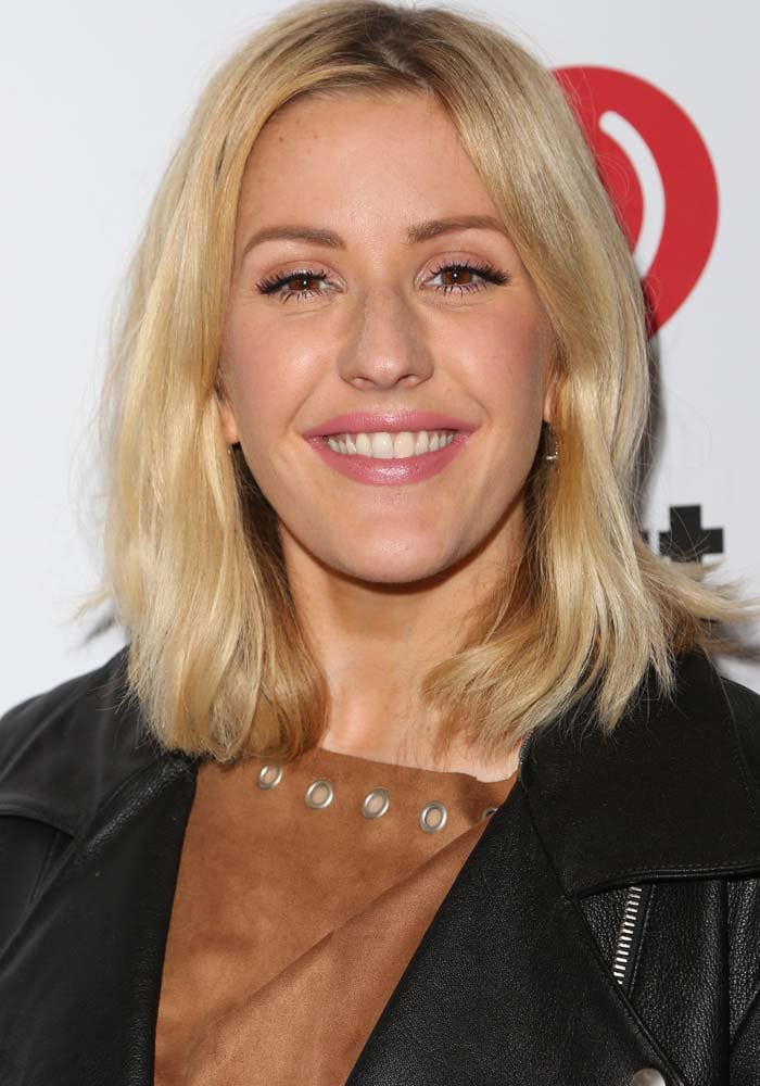 Ellie Goulding smiles as she attends the annual Jingle Ball concert