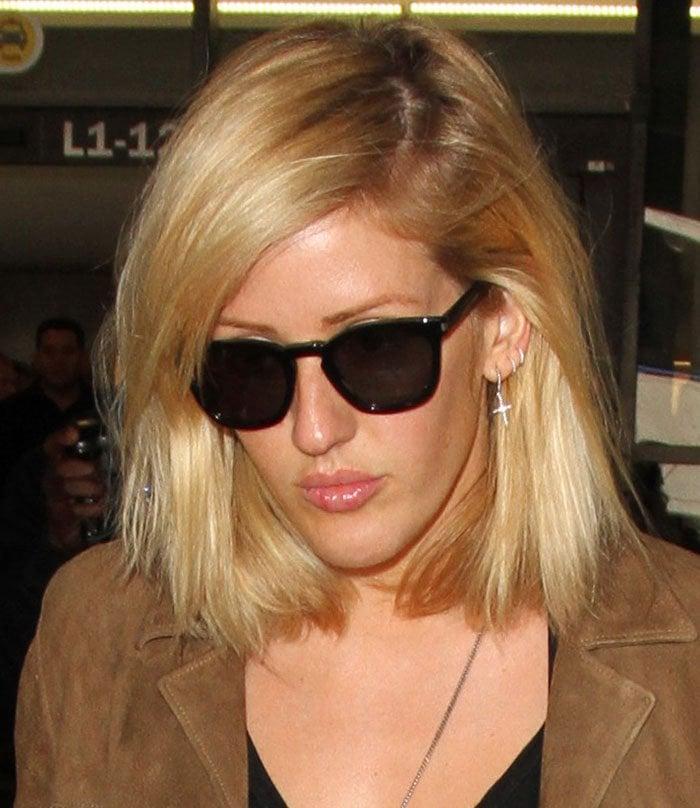 Ellie Goulding wears her blonde hair down as she arrives at Los Angeles International Airport