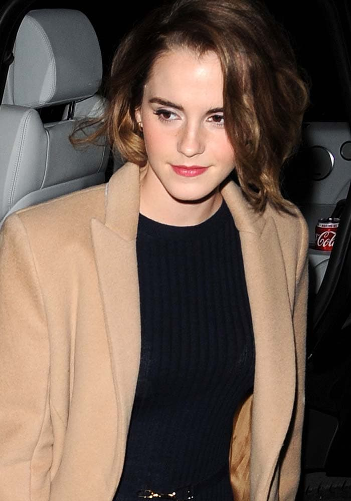 """Emma Watson shows off her new short hair as she attends the film screening of """"The True Cost"""""""