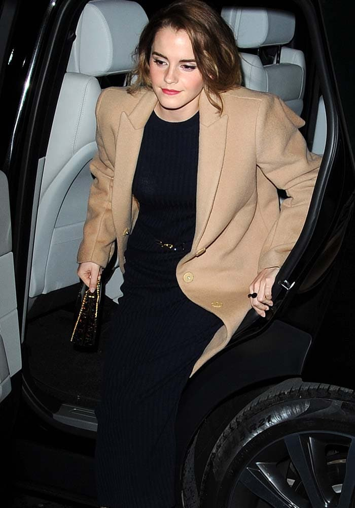 Emma Watson exits a car in order to attend a London film screening