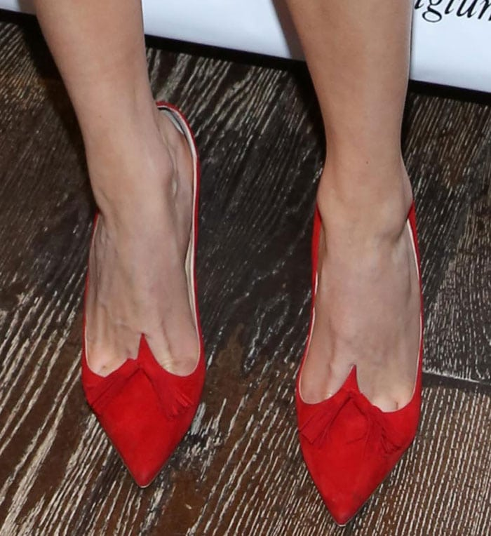 Emmy Rossum's feet in Christian Louboutin pumps