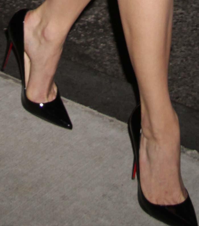 Emmy Rossum wearing Christian Louboutin So Kate pumps