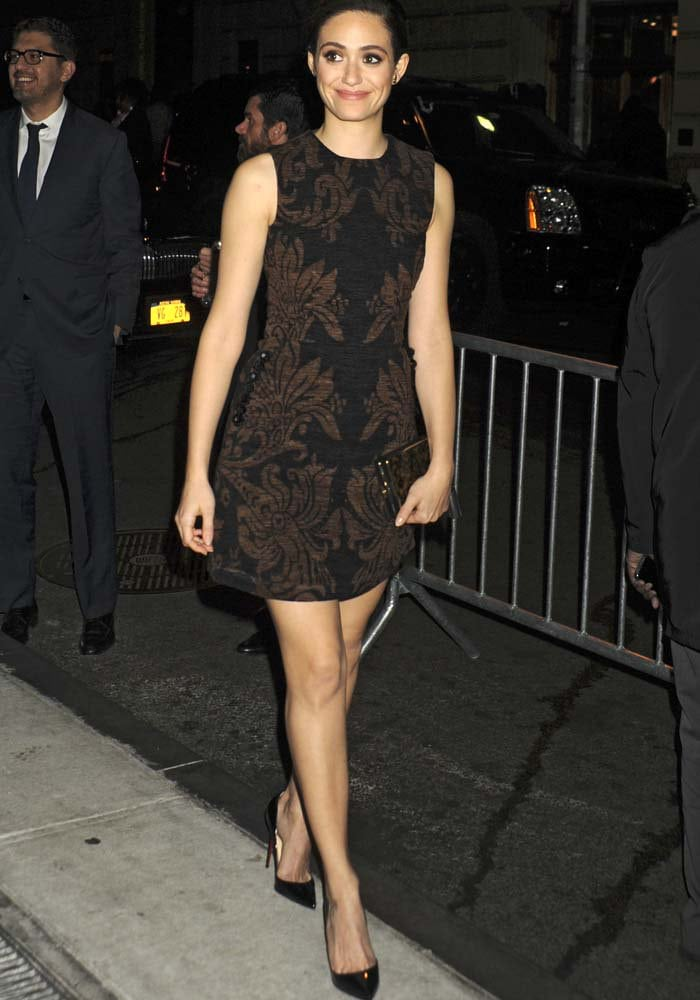 Emmy Rossum wearing an old-Victorian-inspired printed dress by Simone Rocha and jewelry from Ara Vartanian