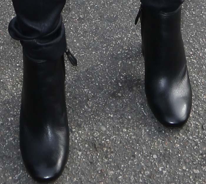 Emmy Rossum's feet in Prada boots