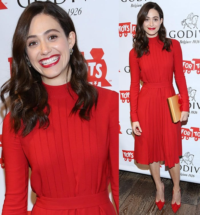 Emmy Rossum contrasts her wavy brunette hair with an all-red look for Christmas