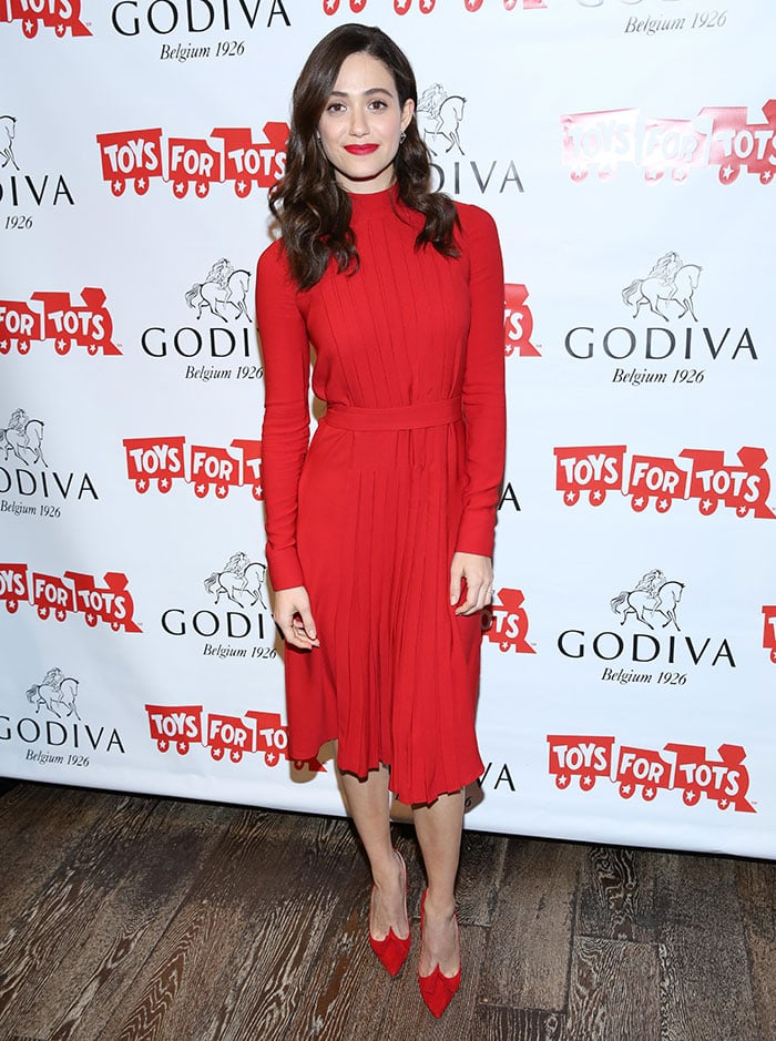 Emmy Rossum matches her red Salvatore Ferragamo dress to a pair of red pumps from Christian Louboutin
