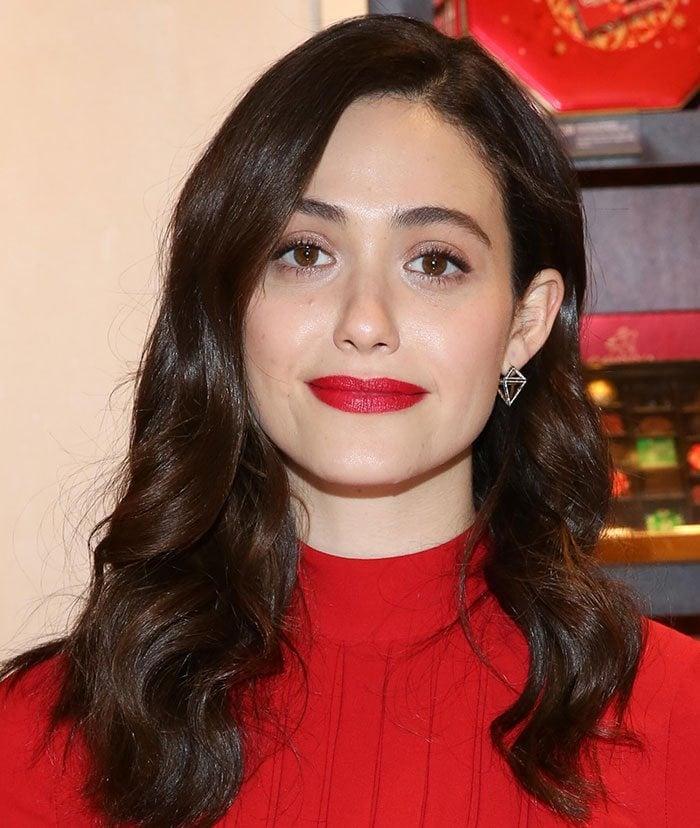 Emmy Rossum wears a pair of geometric earrings from Noor Fares