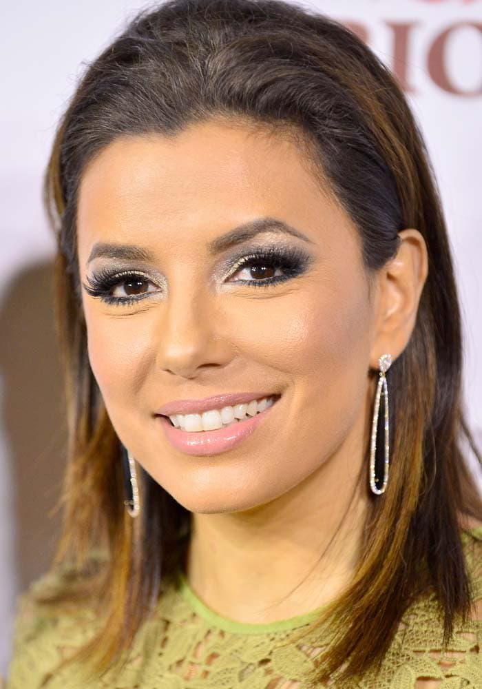 Eva Longoria wears her dark hair down at the Global Gift Foundation Dinner