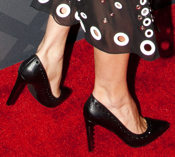 Fergie's black shoes with tonal spiked studs around the collars