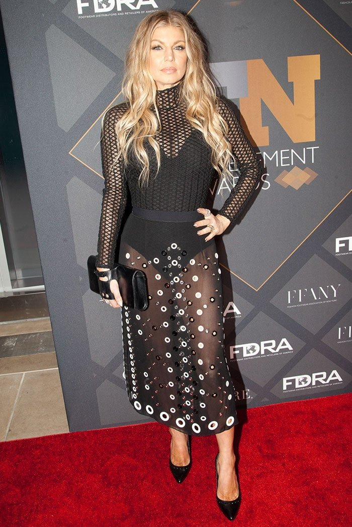 Fergie flashes cleavage in a black mesh David Koma bodysuit