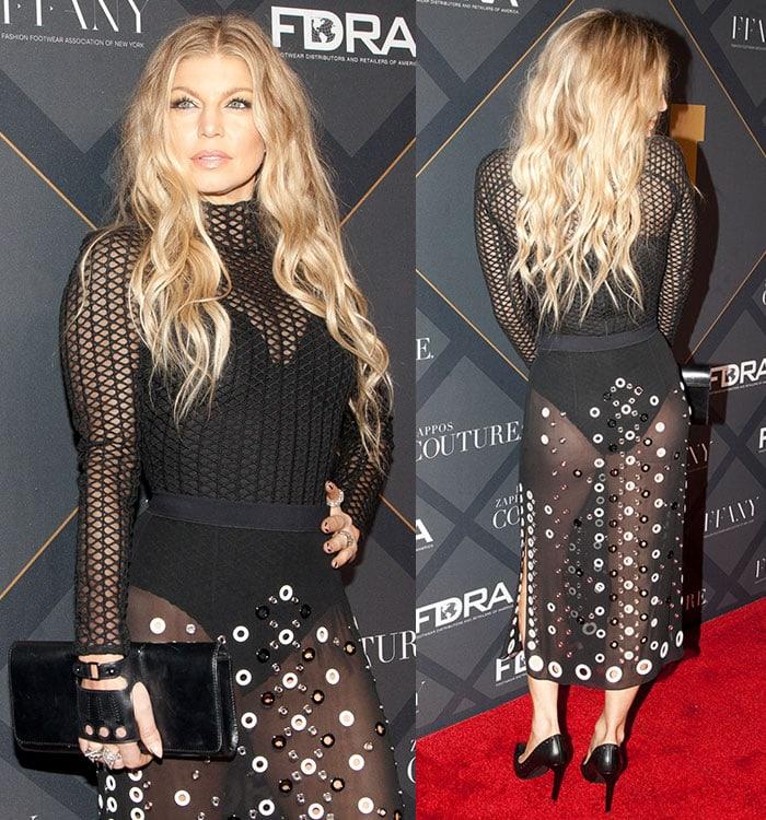 Fergie toted a black Perrin Paris glove clutch