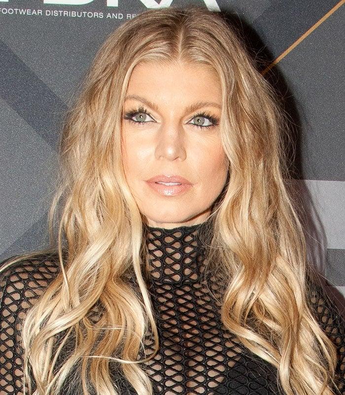 Fergie wears her long blonde hair in loose waves around her shoulders