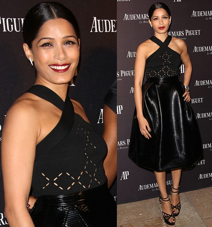 Freida Pinto wears bright red lipstick as she poses for photos in Cushnie Et Ochs