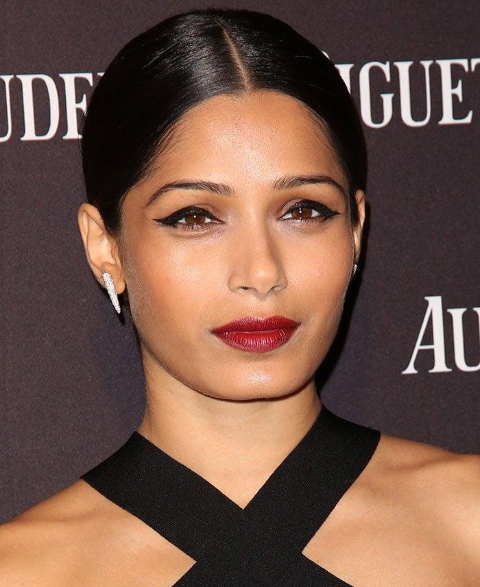 Freida-Pinto-sleek-bun-winged-eyeliner-red-lipstick