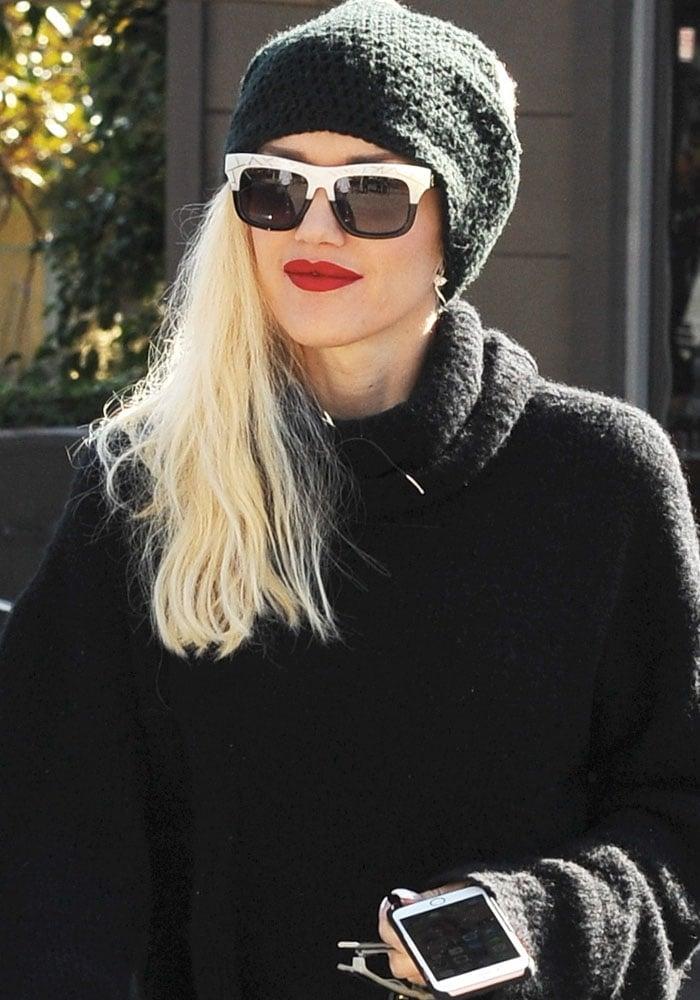 No Doubt's lead vocalist Gwen Stefani wears a beanie over her hair