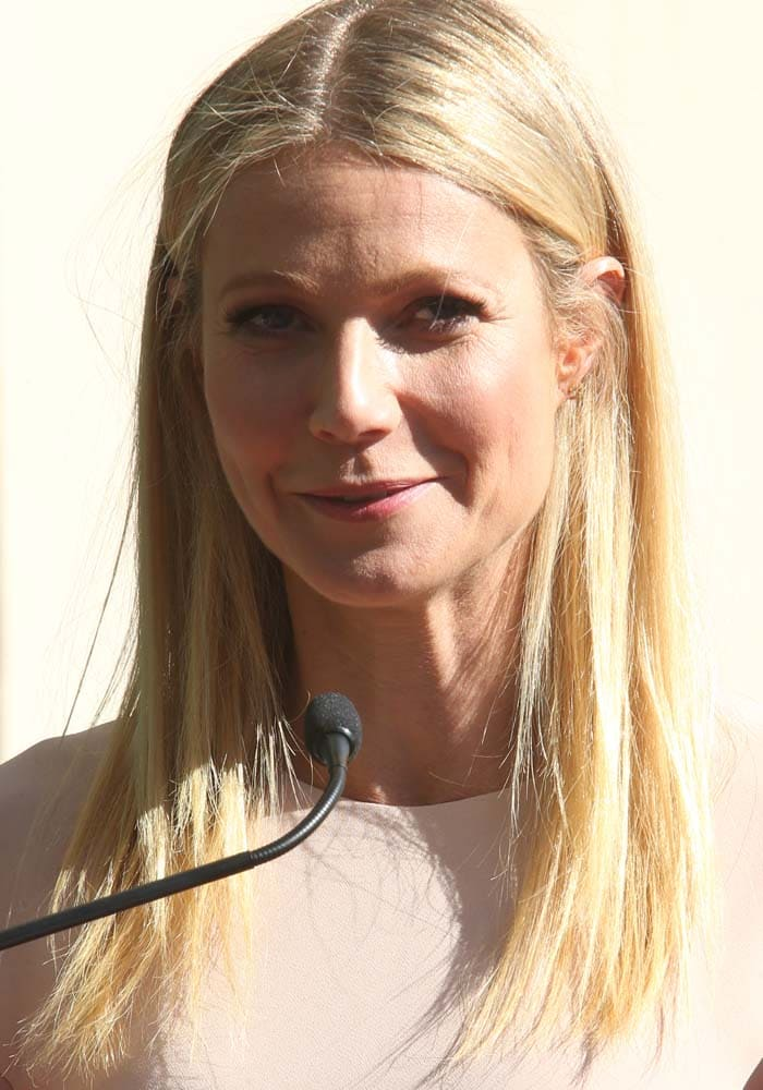 Gwyneth Paltrow wears her blonde hair down as she supports friend Rob Lowe at the Hollywood Walk of Fame