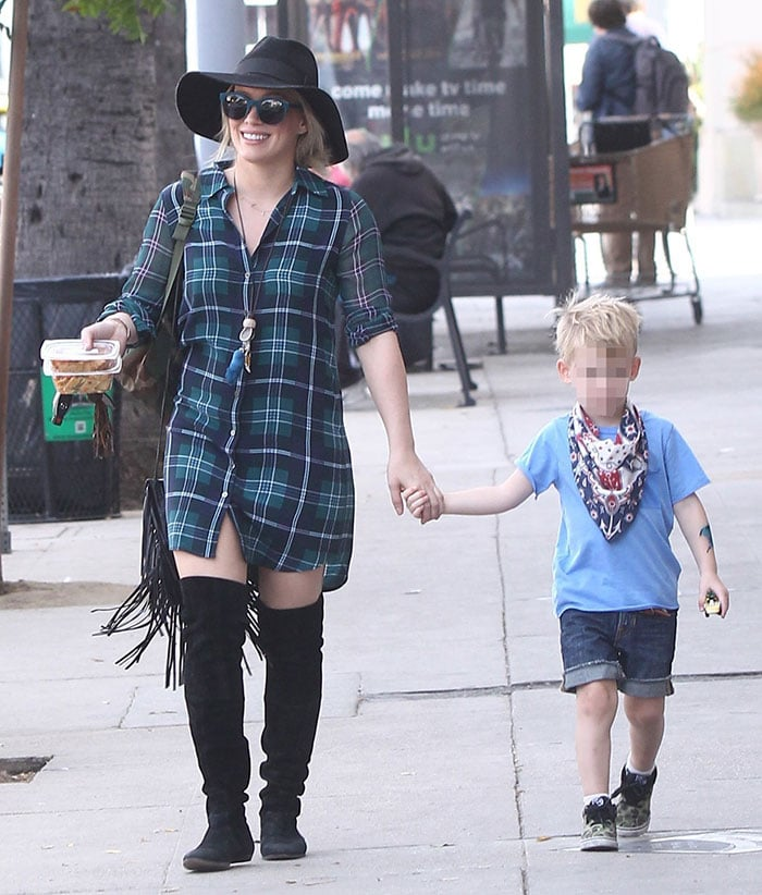 Hilary Duff covers her hair with a trendy hat while out in Studio City with her son Luca