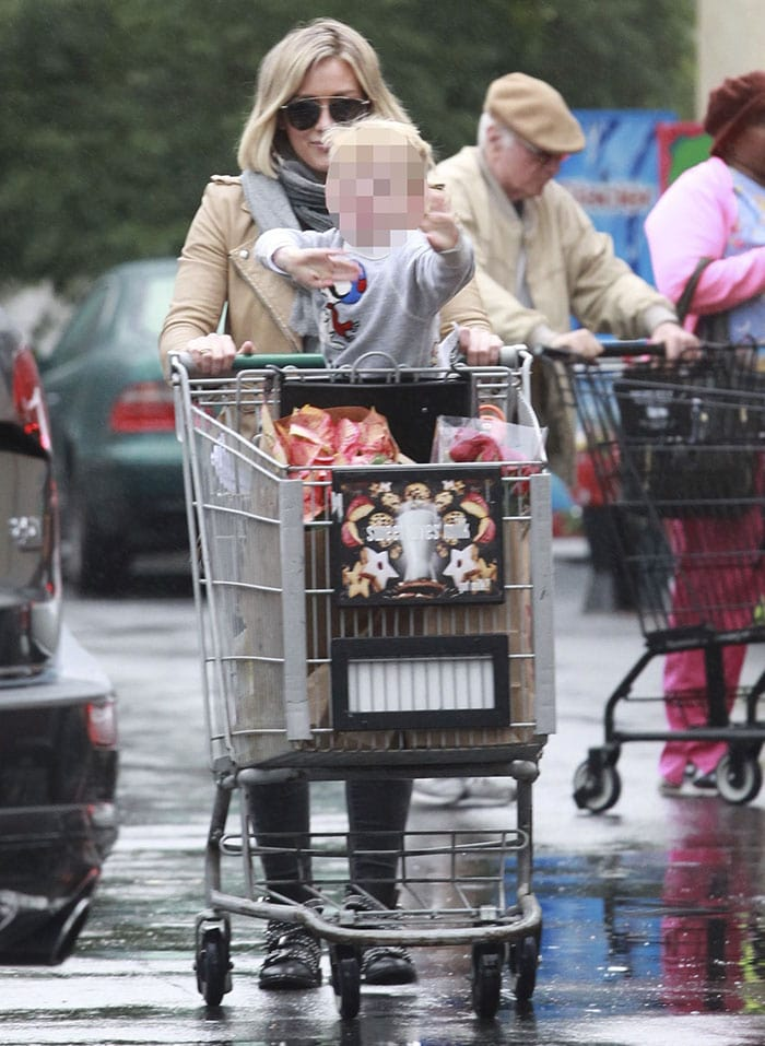 Hilary Duff pushes her son Luca in a shopping cart