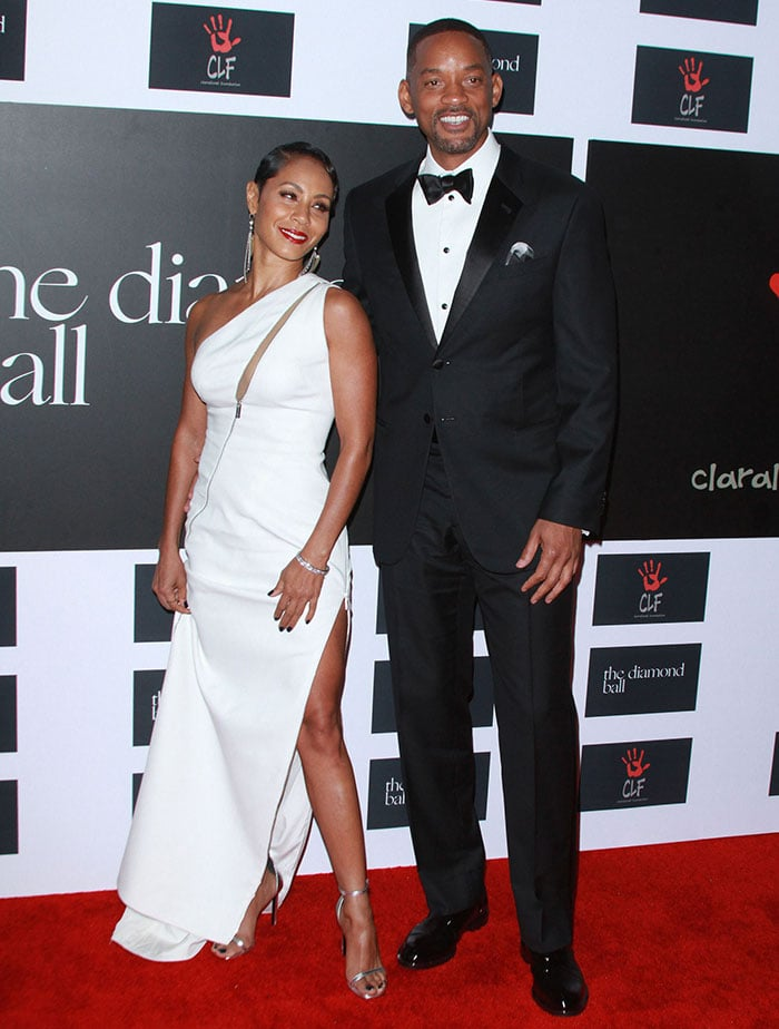 Jada Pinkett Smith and Will Smith pose for photos together on the red carpet