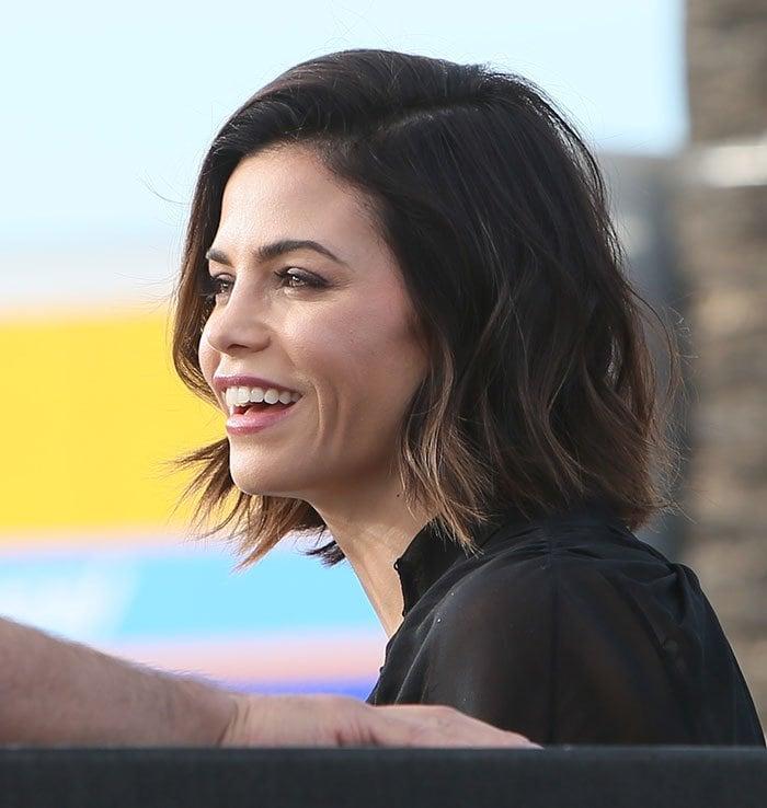 "Jenna Dewan-Tatum smiles broadly as she arrives on the set of ""Extra"""