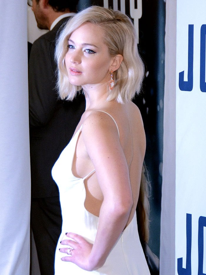 Jennifer Lawrence throws a sultry look over her shoulder in a white Christian Dior gown
