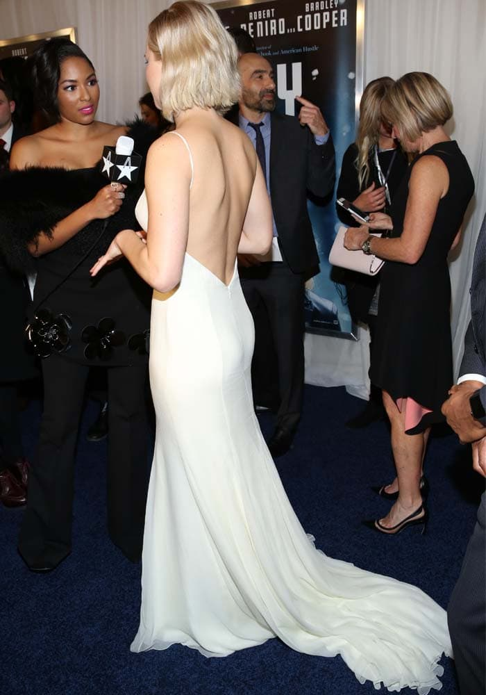 Jennifer Lawrence shows off the train on her white Christian Dior gown
