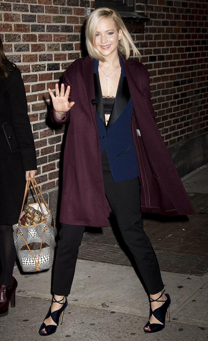 Jennifer-Lawrence-lacy-black-bra-sleeveless-blazer-burgundy-coat