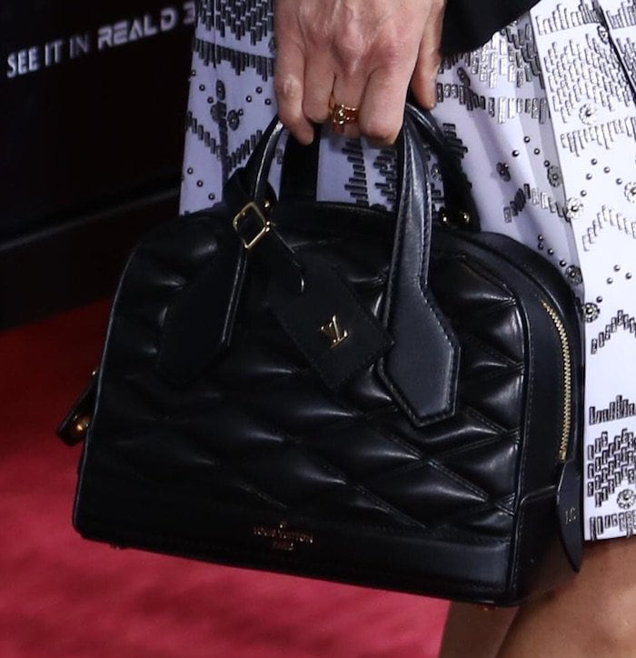 Jennifer Connelly toting a black quilted handbag