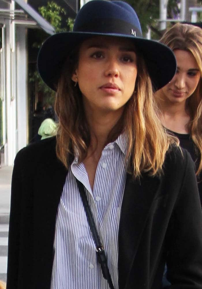 Jessica Alba covers her hair with a hat during a shopping outing in Beverly Hills