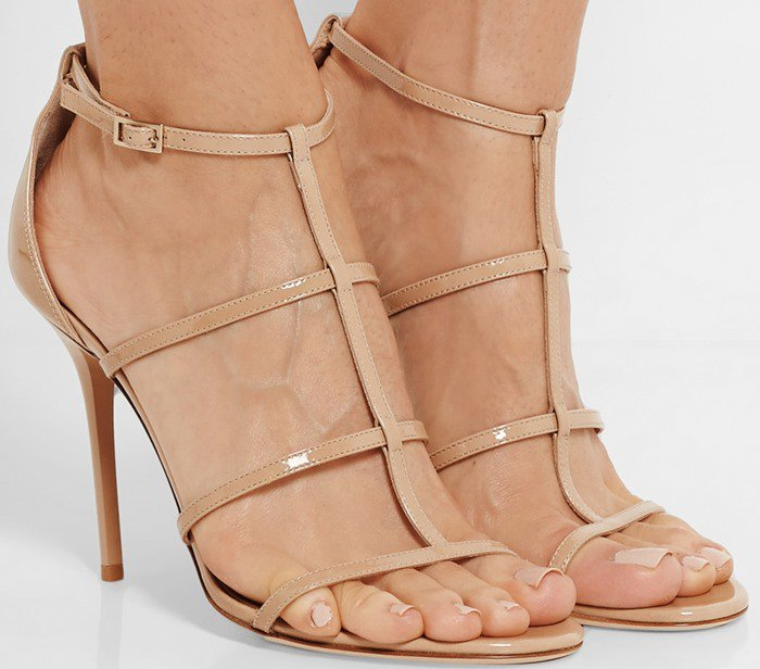 Jimmy Choo's signature 'Dory' sandals have been crafted in Italy from beige patent-leather