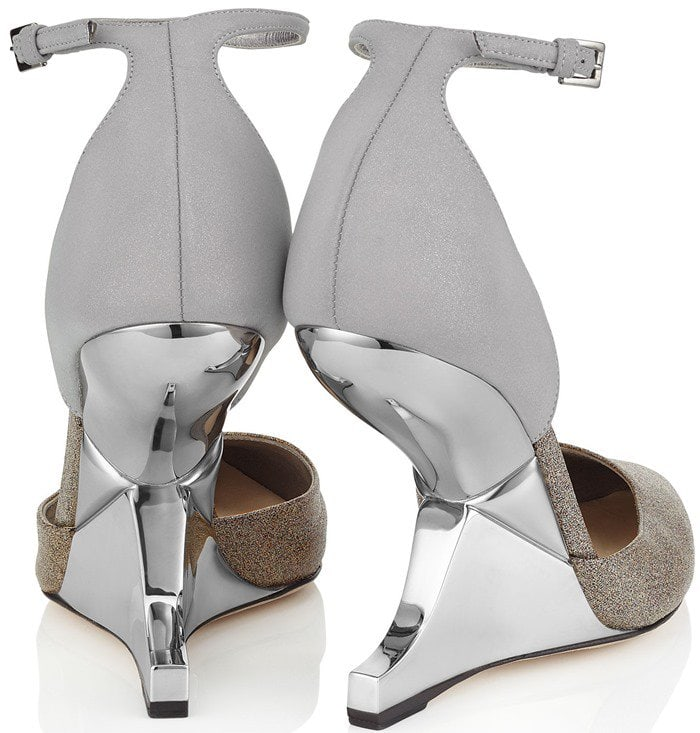 This elegant wedge pump is crafted from a combination of soft black suede and high-shine pewter leather