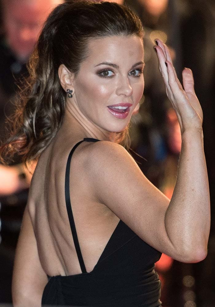Kate Beckinsale waves to the crowd while sporting her signature ponytail