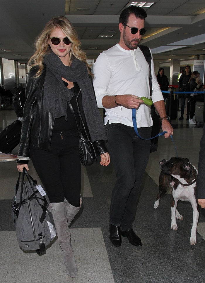 Kate Upton, boyfriend Justin Verlander, and Harley the Boxer stroll through LAX together