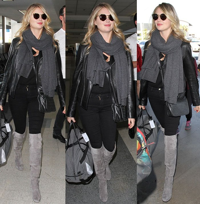 Kate Upton carries a Lululemon travel bag through the Los Angeles airport
