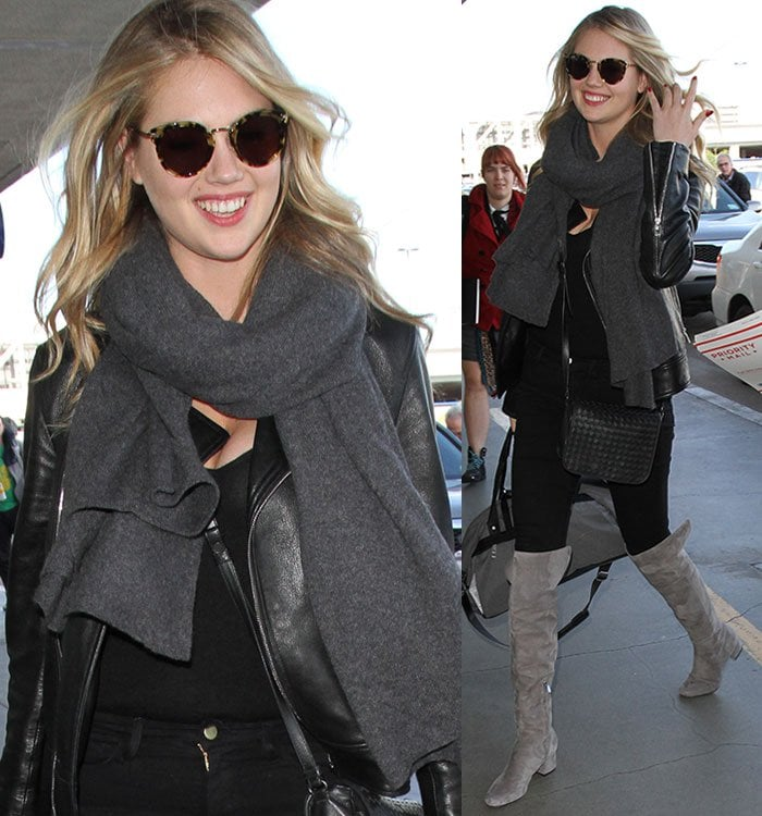 Kate Upton wears sunglasses and a gray scarf as she strolls through LAX