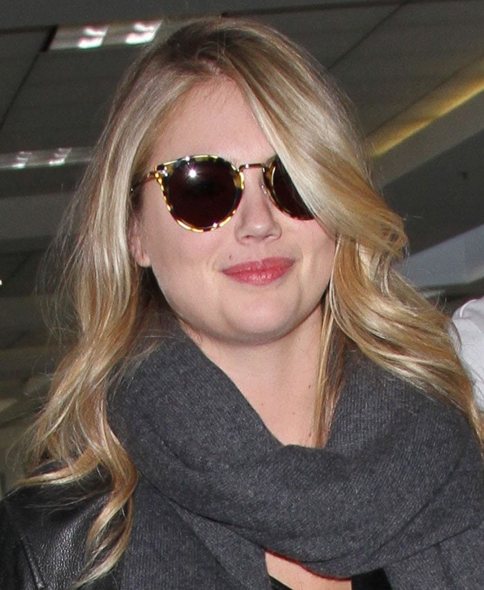 Kate Upton wears her hair down as she catches a flight at Los Angeles International Airport