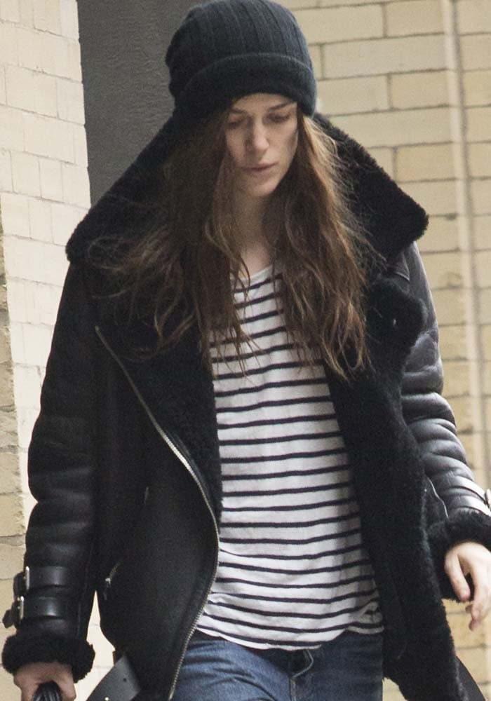 Keira Knightley covers her hair with a beanie as she leaves her Broadway matinee performance
