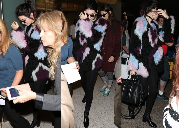 Kendall Jenner wears an Elizabeth and James jacket as she arrives at LAX