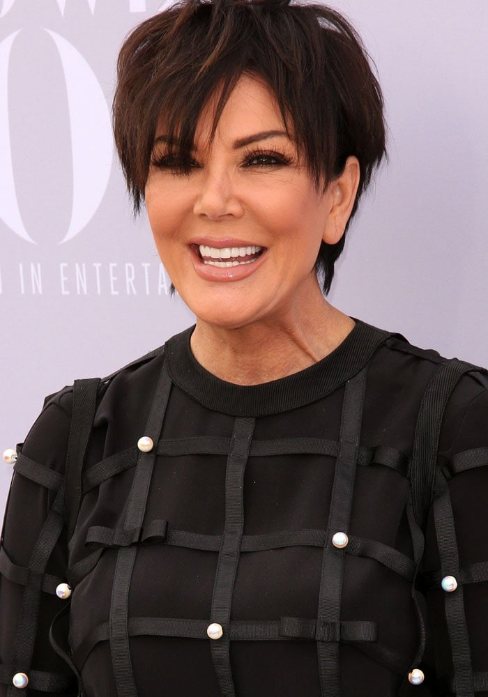 Kris Jenner wears her hair in its trademark pixie style on the red carpet of the 24th annual Women in Entertainment Breakfast hosted by The Hollywood Reporter