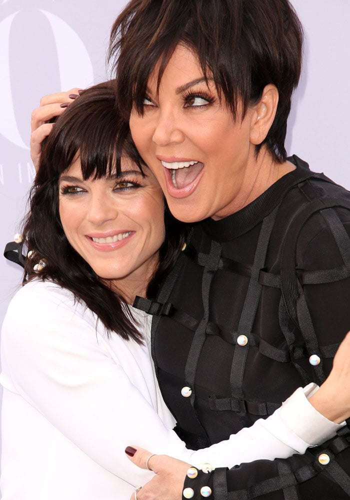 Selma Blair and Kris Jenner embrace on the red carpet