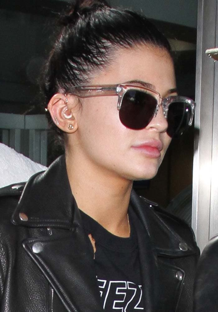 Kylie Jenner wears her hair up as she arrives at Los Angeles International Airport