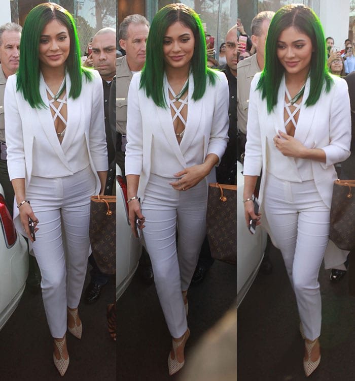 Kylie-Jenner-cleavage-white-Olcay-Gulsen-long-tail-caot