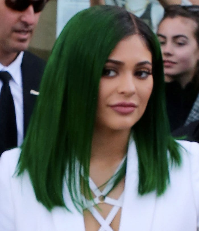 Kylie Jenner debuts her new green hair as she launches her latest line of lip glosses