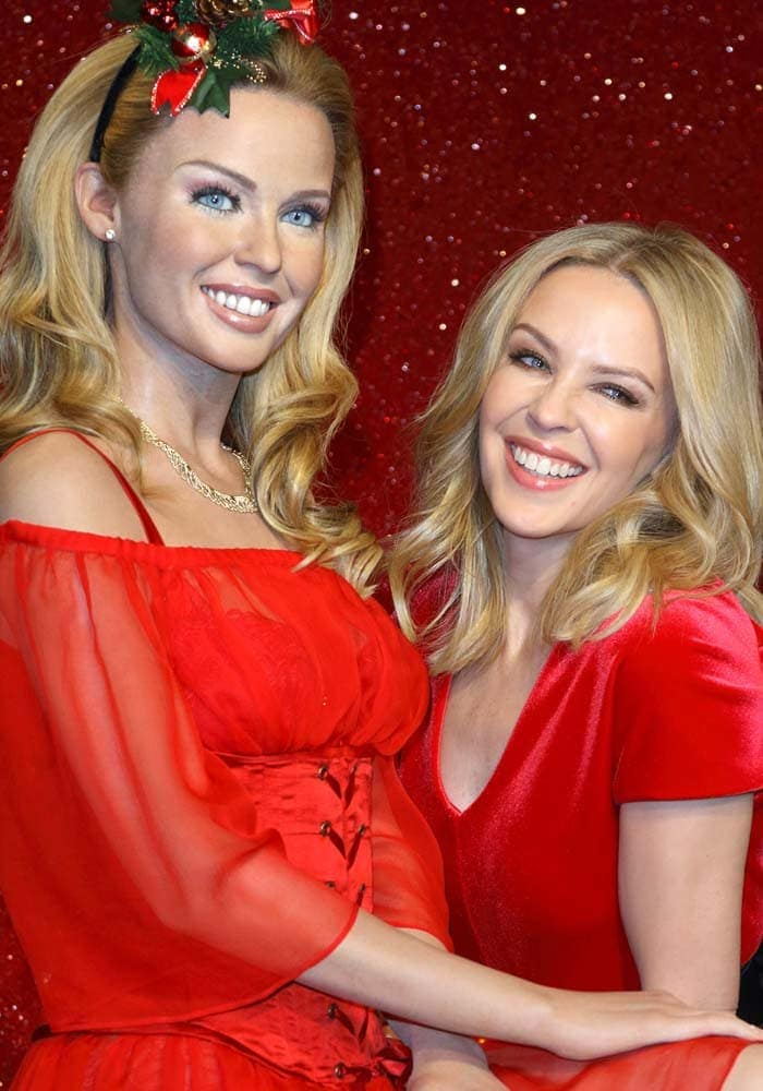 Kylie Minogue visits her wax figure at Madame Tussaud's