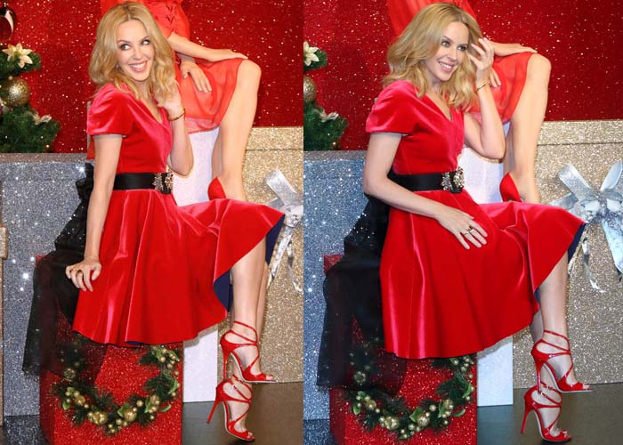 Kylie Minogue flaunted her legs in a red flared dress