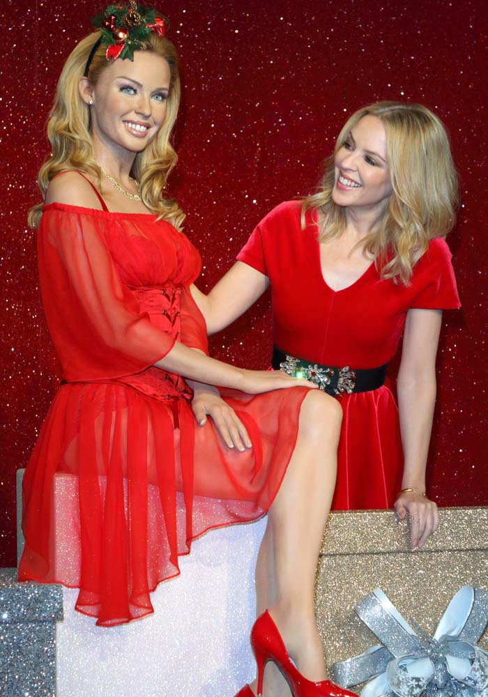 Kylie Minogue poses with her wax figure at Madame Tussauds in London