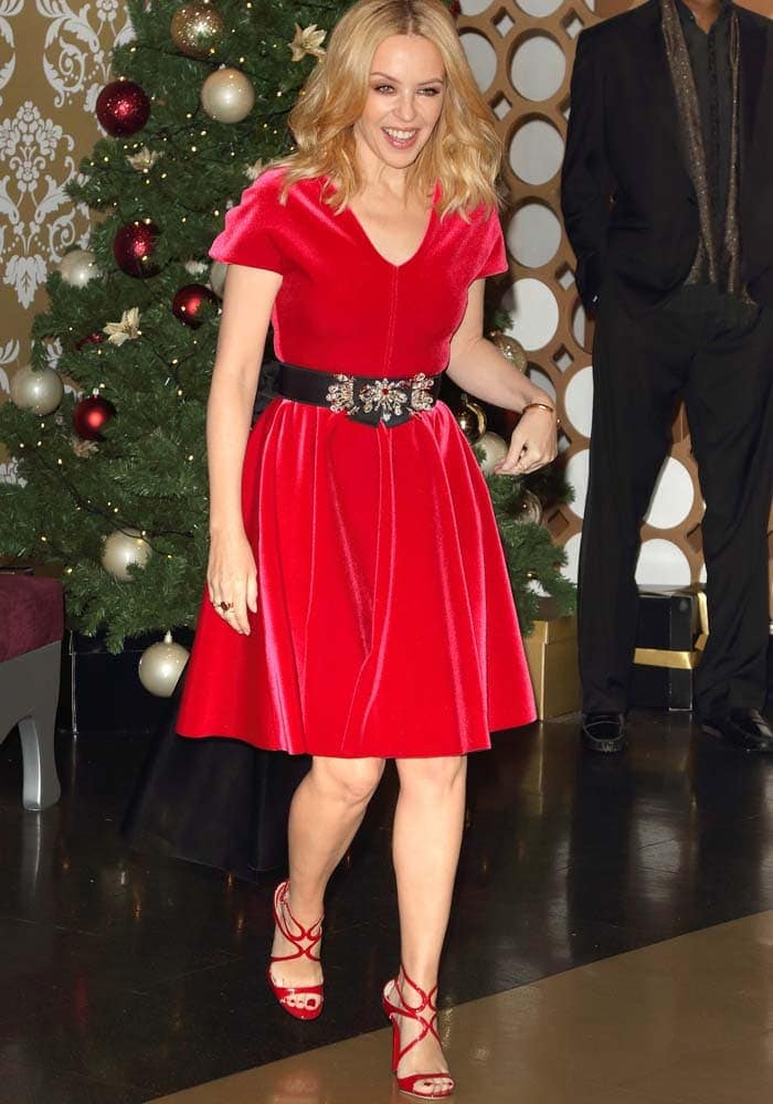 Kylie Minogue flaunts her legs in a red dress with matching heels