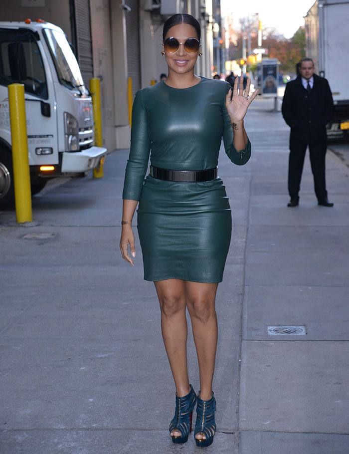 La La Anthony wears a skintight green leather dress out in New York City
