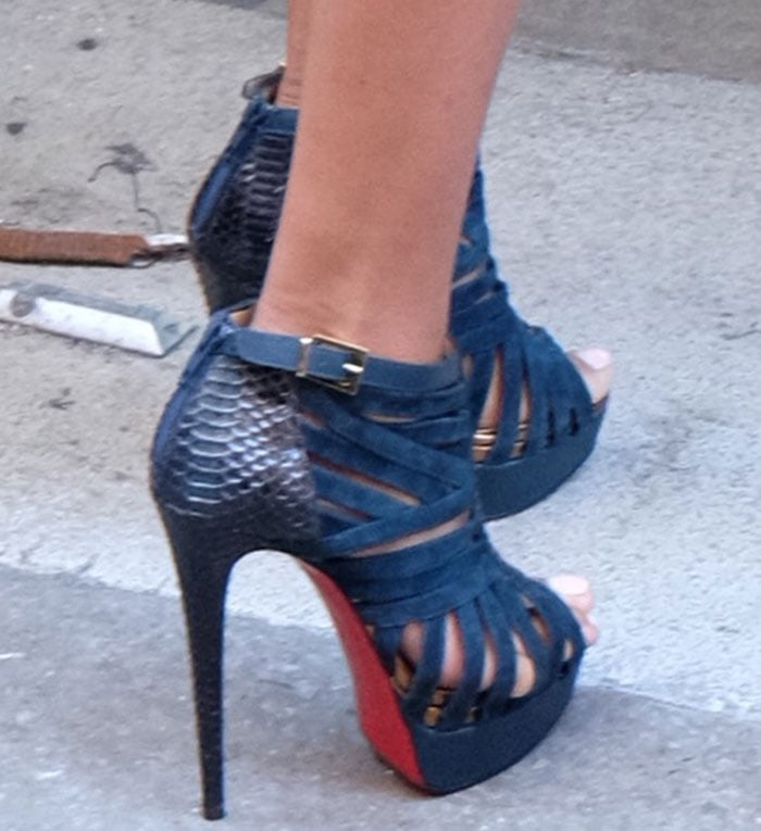 La La Anthony's feet in Christian Louboutin booties